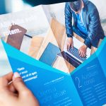 Hands holding a business brochure, close up - Safeguard by Prime